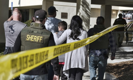 Family members are led into the Thousand Oaks Teen Center where families have gathered after a deadly shooting at a bar on Thursday, Nov. 8,2018, in Thousand Oaks, Calif.