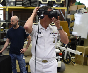 Rear Adm. David Hahn, chief of naval research, tours the National Robotics Engineering Center while attending the AI & Autonomy for Humanitarian Assistance and Disaster Relief workshop, co-hosted by the Office of Naval Research and Carnegie Mellon Univ.