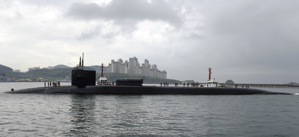 In this Monday, April 24, 2017 photo released by the U.S. Navy, the Ohio-class guided-missile submarine USS Michigan arrives in Busan, South Korea, for a scheduled port visit while conducting routine patrols throughout the western Pacific.