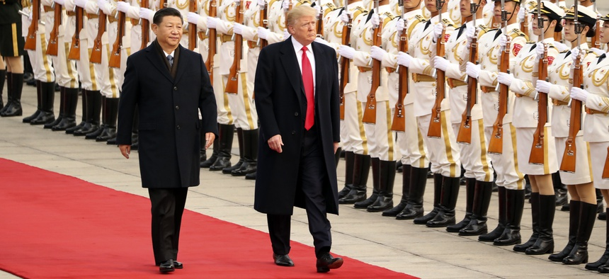President Donald Trump and Chinese President Xi Jinping participate in a welcome ceremony at the Great Hall of the People, Thursday, Nov. 9, 2017, in Beijing, China.
