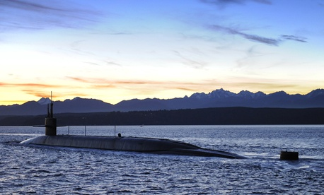 The ballistic-missile submarine USS Nevada (SSBN 733) transits the Puget Sound on its way to its homeport, Naval Base Kitsap-Bangor in Poulsbo, Wash. Jan. 14, 2015.