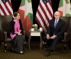 U.S. Vice President Mike Pence, right, meets Myanmar leader Aung San Suu Kyi in Singapore, Wednesday, Nov. 14, 2018.