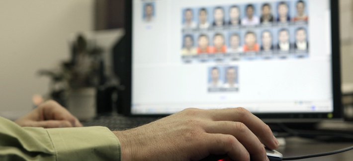 Stephen Lamm, supervisor with the ID Fraud Unit of the North Carolina Department of Motor Vehicles looks through photos in the facial recognition system Thursday, Sept. 24, 2009 in Raleigh, N.C.