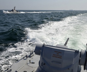 In this file photo taken and distributed by Ukrainian Navy Press Service on Sunday, Nov. 25, 2018, two Ukrainian forces navy ships are seen near Crimea.