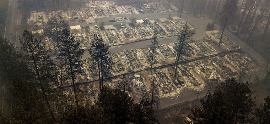 In this Nov. 15, 2018, file photo, residences leveled by the wildfire line a neighborhood in Paradise, Calif.