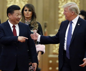 In this Nov. 9, 2017, file photo, U.S. President Donald Trump China's President Xi Jinping arrive for the state dinner with the first ladies at the Great Hall of the People in Beijing, China.