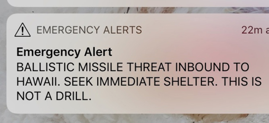 A smartphone screen capture showing a false incoming ballistic missile emergency alert sent from the Hawaii Emergency Management Agency system.