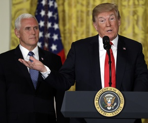 President Donald Trump speaks at a June 2018 meeting of the National Space Council, which is led by Vice President Mike Pence, left.