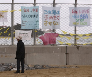 A 2014 shows banners hung to protest the move of U.S. Marine Corps forces from Okinawa to Henoko, Japan.