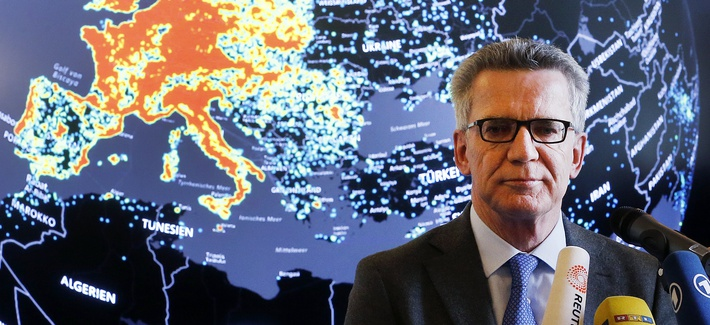 German Interior Minister Thomas de Maiziere talks to the media during his visit of the central point of fighting internet criminality (ZIT) in Giessen, Germany, Wednesday, Feb. 8, 2017.