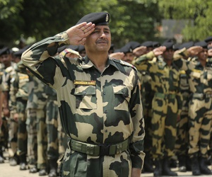 Indian Border Security Force soldiers pay tribute to two colleagues during a wreath-laying ceremony at the BSF headquarters in Jammu, India, Sunday, June. 3, 2018.