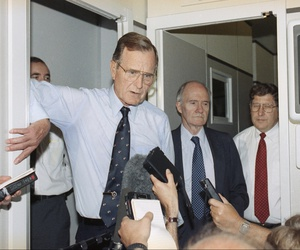 President George Bush speaks to reporters aboard Air Force One, June 1, 1991 to praise the U.S.-Soviet accord on reducing non-nuclear weapons in Europe.