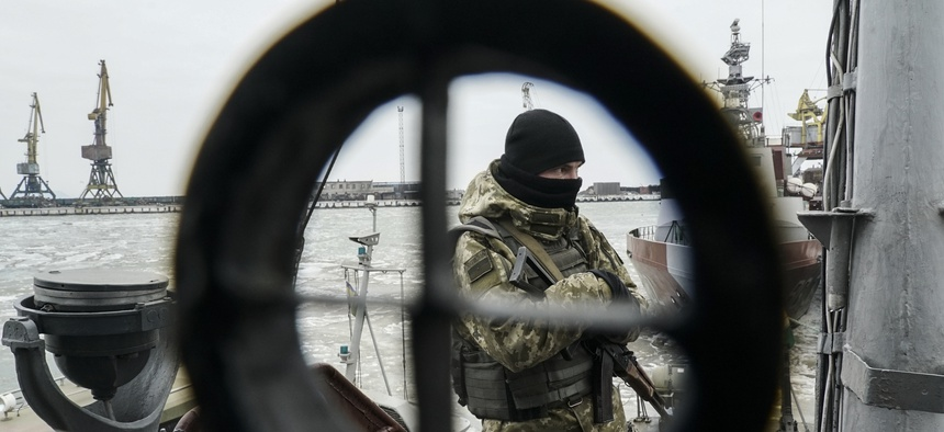 A Ukrainian serviceman stands on board a coast guard ship in the Sea of Azov port of Mariupol, eastern Ukraine, Monday, Dec. 3, 2018. The Ukrainian military has been on increased readiness as part of martial law introduced in the country.