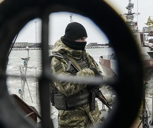 A Ukrainian serviceman stands on board a coast guard ship in the Sea of Azov port of Mariupol, eastern Ukraine, Monday, Dec. 3, 2018.