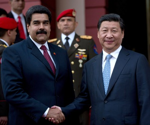 China's President Xi Jinping, right, shakes hand of Venezuela's President Nicolas Maduro, left, prior their meeting at Miraflores Presidential palace in Caracas, Venezuela, Sunday, July 20, 2014.