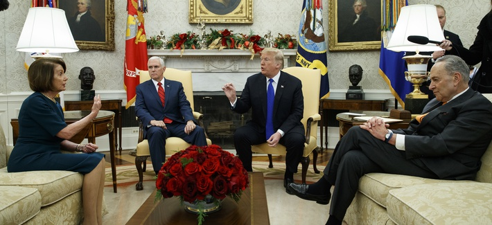 House Minority Leader Rep. Nancy Pelosi, D-Calif., Vice President Mike Pence, President Donald Trump, and Senate Minority Leader Chuck Schumer, D-N.Y., argue during a meeting in the Oval Office of the White House, Dec. 11, 2018.