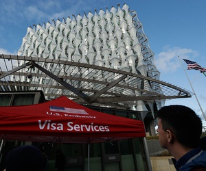 A Visa Services gazebo stands outside as the first group of Visa applicants to go into the new United States Embassy building in London, wait in line outside, Tuesday, Jan. 16, 2018.