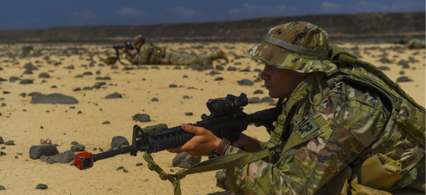 U.S. service members assigned to the Combined Joint Task Force - Horn of Africa keep watch as their platoon set ups an objective rally point on the first day of a French Desert Commando Course at the Djibouti Range Complex near Arta, Djibouti, Nov. 26, 20