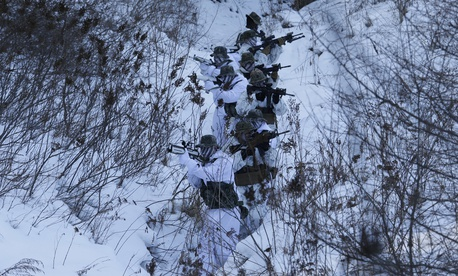 In this Tuesday, Dec. 19, 2017, file photo, South Korean and U.S. Marines from III-Marine Expeditionary Force from Okinawa, Japan, patrol on the snow during their joint military winter exercise in Pyeongchang, South Korea.