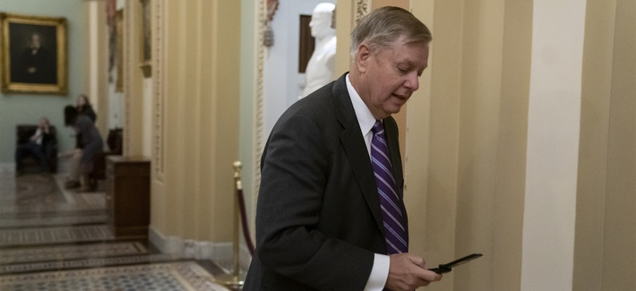 "Sen. Lindsey Graham, R-S.C., rushes to the office of Senate Majority Leader Mitch McConnell, R-Ky., on Dec. 19, 2018. Graham called Trump's apparent decision to withdraw all U.S. troops from Syria ""a disaster in the making."""