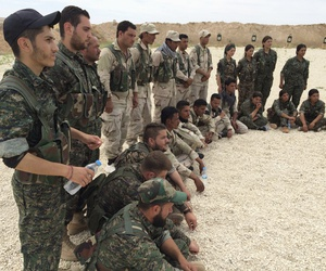 In this file photo taken May 21, 2016, members of what the U.S. calls the Syrian Democratic Forces gather after a training session at a firing range in northern Syria.