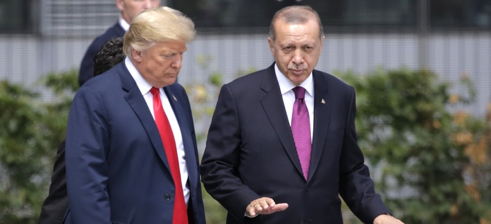U.S. President Donald Trump, left, talks with Turkish President Recep Tayyip Erdogan during a summit of heads of state and government at NATO headquarters in Brussels Wednesday, July 11, 2018.