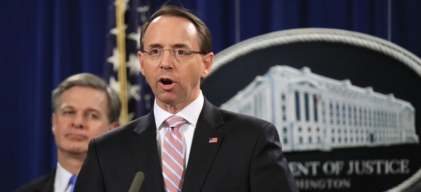 Deputy Attorney General Rod Rosenstein with FBI Director Christopher Wray, speaks during a news conference at the Department of Justice in Washington, Thursday, Dec. 20, 2018.