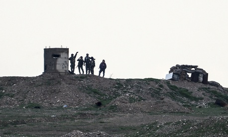 Fighters of People's Protection Units, or YPG, gather at their outpost west of the city of Kobani, northern Syria, Tuesday, Dec. 18, 2018.