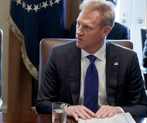Deputy Secretary of Defense Patrick Shanahan, right, listen as President Donald Trump speaks during a cabinet meeting at the White House.