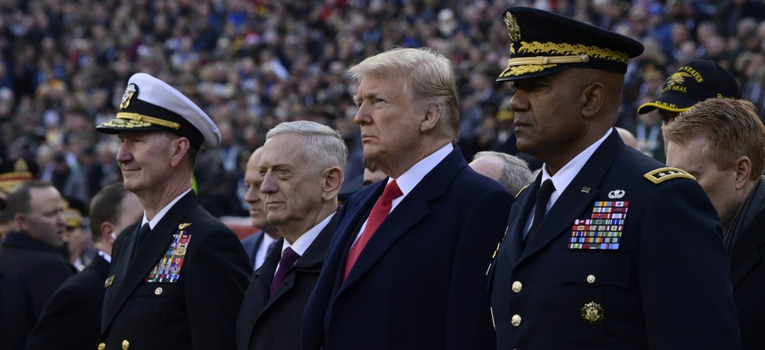 President Donald Trump, center, stands with Defense Secretary Jim Mattis, second from left, during pregame ceremonies at the Army-Navy NCAA college football game in Philadelphia, Saturday, Dec. 8, 2018.