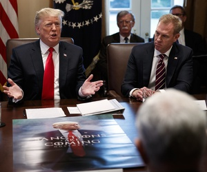 Acting Secretary of Defense Patrick Shanahan, right, listens as President Donald Trump speaks during a cabinet meeting at the White House, Wednesday, Jan. 2, 2019, in Washington.