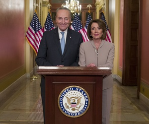 Senate Minority Leader Chuck Schumer of N.Y., and House Speaker Nancy Pelosi of Calif., pose for photographers after speaking on Capitol Hill in response President Donald Trump's address, Tuesday, Jan. 8, 2019.