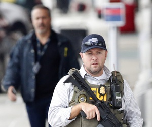 FBI agents walk outside the terminal at Fort Lauderdale–Hollywood International Airport, after a gunman opened fire on  Jan. 6, 2017, in Fort Lauderdale, Fla.