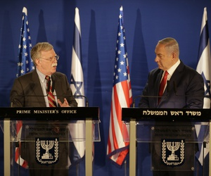 US National Security Advisor John Bolton, left, speaks to Israeli Prime Minister Benjamin Netanyahu during a joint statement to the media follow their meeting, in Jerusalem, Sunday, Jan. 6, 2019.