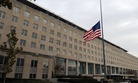 The U.S. flag flies hang at half-staff at the U.S. Department of State in Washington, D.C., on November 22, 2013.