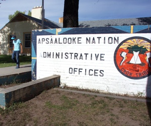 A boy is seen walking past the Crow Tribe's administrative offices in Crow Agency, Montana, Oct. 2, 2013.