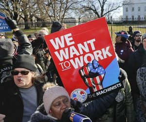 Union members and other federal employees rally outside the White House last week to end the partial shutdown.