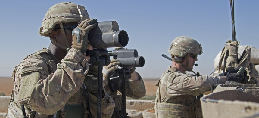 In this Nov. 1, 2018, photo released by the U.S. Army, soldiers surveil the area during a combined joint patrol in Manbij, Syria.