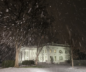 Snow falls at the White House on Thursday.