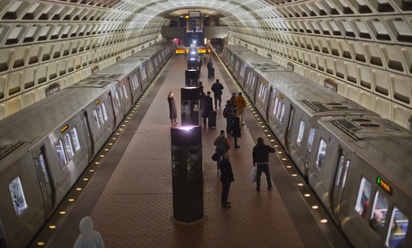 Passengers board subway trains at the Naval Yard-Ballpark Metro Station, Thursday, Feb. 8, 2018, part of the public transit network for Washington.