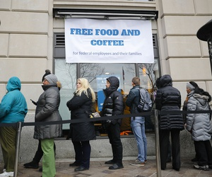 People wait in line at Chef Jose Andres' World Central Kitchen for free meals to workers effected by the government shutdown in Washington, Wednesday, Jan. 16, 2019.