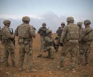 U.S. Soldiers gather for a brief during a combined joint patrol rehearsal in Manbij, Syria, in November.