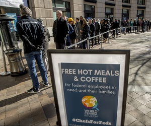 Furloughed workers wait in line to receive food and supplies from World Central Kitchen, the not-for-profit organization started by Chef Jose Andres in Washington, Tuesday, Jan. 22, 2019.