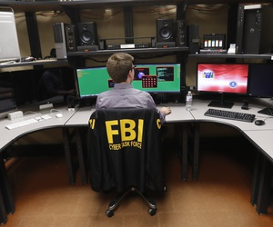In this Tuesday, July 31, 2018, photo, an FBI employee works in a computer forensics lab at the FBI field office in New Orleans.