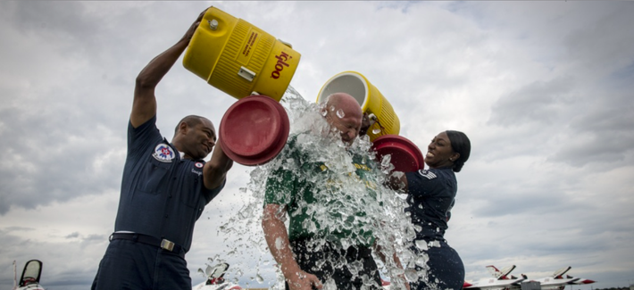 Air Force servicemembers do their part to raise awareness for ALS with the Ice Bucket Challenge in 2014.