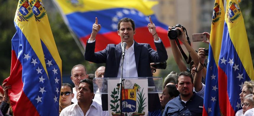 Juan Guaido, head of Venezuela's opposition-run congress, declares himself interim president of the nation until elections can be held during a rally demanding President Nicolas Maduro's resignation in Caracas, Venezuela, Wednesday, Jan. 23, 2019.