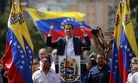 Juan Guaido, head of Venezuela's opposition-run congress, declares himself interim president of the nation until elections can be held during a rally demanding President Nicolas Maduro's resignation in Caracas, Venezuela, Wednesday, Jan. 23, 2019.