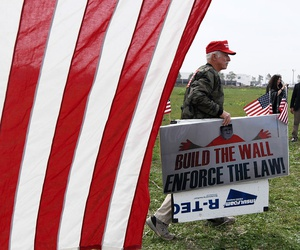 A supporter of President Donald Trump walks by during a 2018 rally in San Diego.