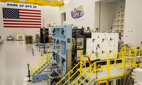 A GPS III satellite being built at a Lockheed Martin factory in Colorado. Harris builds the satellite's navigation payload.