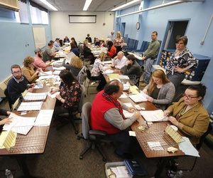 Ballots are recounted in Maine's 2nd Congressional District, Thursday, Dec. 6, 2018, in Augusta, Maine.